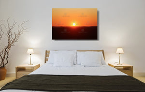 An acrylic print of a perfect sunset in outback NSW hanging in a bed room setting