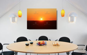 An acrylic print of a perfect sunset in outback NSW hanging in a dining room setting