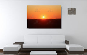 An acrylic print of a perfect sunset in outback NSW hanging in a lounge room setting