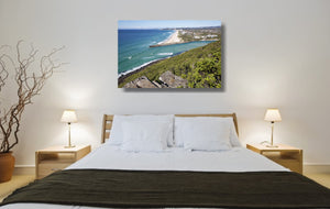 An acrylic print of Palm Beach on the Gold Coast, QLD hanging in a bed room setting