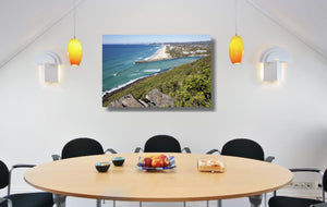 An acrylic print of Palm Beach on the Gold Coast, QLD hanging in a dining room setting