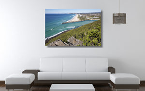 An acrylic print of Palm Beach on the Gold Coast, QLD hanging in a lounge room setting