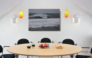 An acrylic print of Sandon Point in Wollongong NSW hanging in a dining room setting