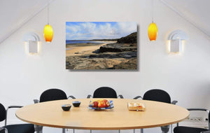 Acrylic print of Racecourse Beach in Ulladulla hanging in a dining room setting.