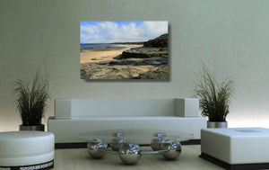 Acrylic print of Racecourse Beach in Ulladulla hanging in a colourful lounge room setting.