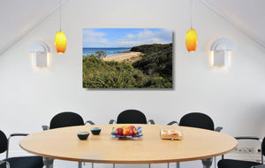 An acrylic print of Rennies Beach in Ulladulla NSW hanging in a dining room setting