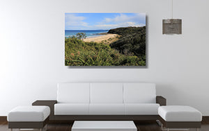 An acrylic print of Rennies Beach in Ulladulla NSW hanging in a lounge room setting