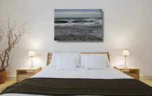An acrylic print of Sandon Point in Wollongong NSW hanging in a bed room setting