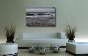 An acrylic print of Sandon Point in Wollongong NSW hanging in a lounge room setting