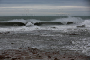 Photograph of a large wave breaking in two sections at Sandon Point NSW