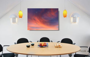 An acrylic print of a soft pastel sunset at Paradise Point QLD in hanging in a dining room setting