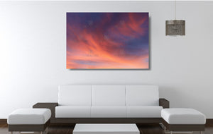An acrylic print of a soft pastel sunset at Paradise Point QLD in hanging in a lounge room setting