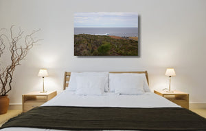 An acrylic print of a wave breaking off Surfers Point at Margaret River WA hanging in a bed room setting