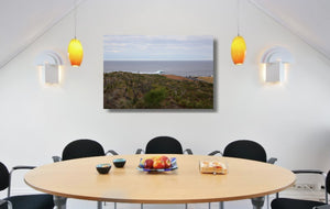 An acrylic print of a wave breaking off Surfers Point at Margaret River WA hanging in a dining room setting