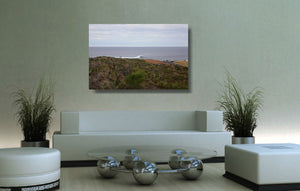 An acrylic print of a wave breaking off Surfers Point at Margaret River WA hanging in a lounge room setting