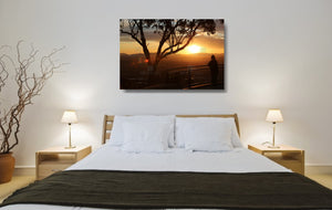 An acrylic print of a lone person standing at a lookout in Tamworth at sunset in hanging in a bed room setting