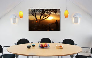 An acrylic print of a lone person standing at a lookout in Tamworth at sunset in hanging in a dining room setting