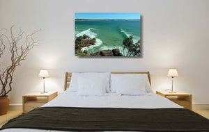 An acrylic print of The Pass at Byron Bay NSW hanging in a bed room setting