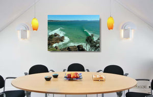 An acrylic print of The Pass at Byron Bay NSW hanging in a dining room setting