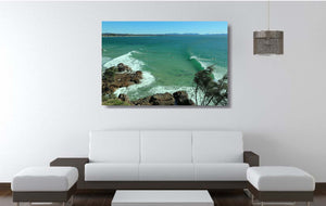 An acrylic print of The Pass at Byron Bay NSW hanging in a lounge room setting