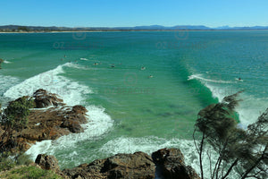 Photograph of surfers on a sunny day - The Pass, Byron Bay NSW