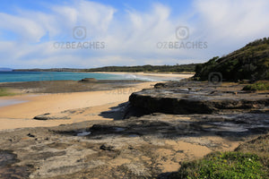 Photograph of a sunny, uncrowded day at Racecourse Beach, Ulladulla NSW