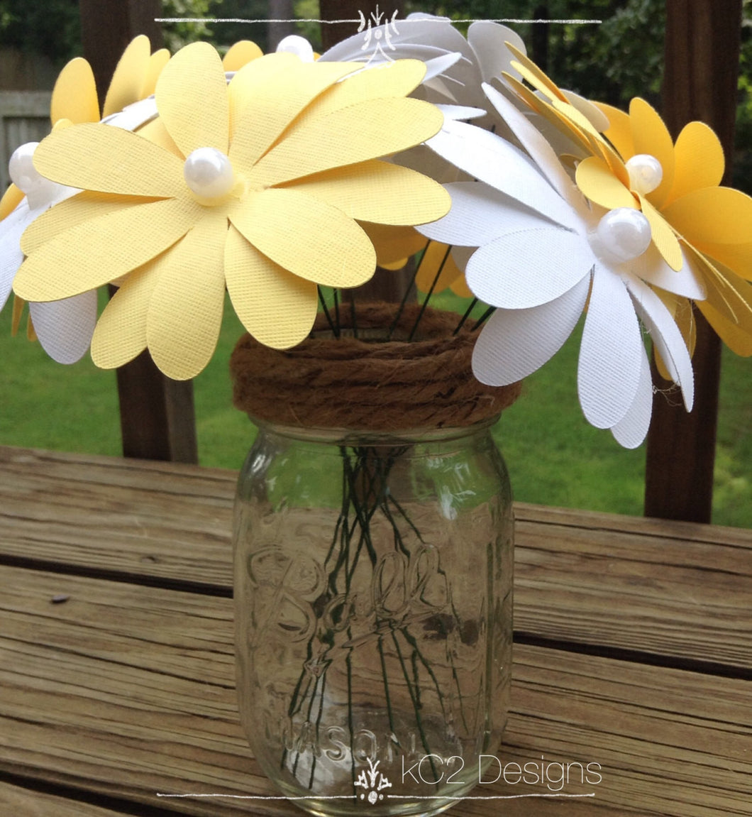 Paper flowers. Paper daisies. Wedding centerpieces. Yellow and white flowers were. Giant daisies. Gerbera daisies. Wedding bouquet. Summer