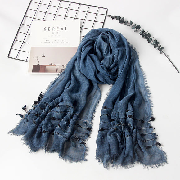Blue scarf with woven balls