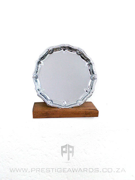 Silver metal tray with ornate edge on base