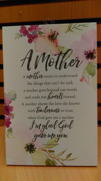 Plaque: A Mother