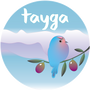 Tayga logo with a bird perched on an olive tree branch against a backdrop of mountains.