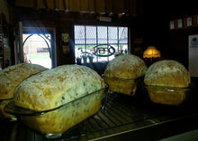 Load image into Gallery viewer, 4 loaves of Sunflower Seed Bread cooling in the pans.