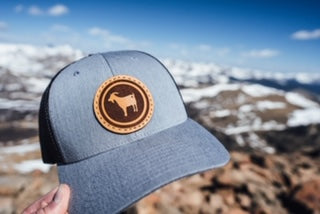 OneGoat hat and the mountains