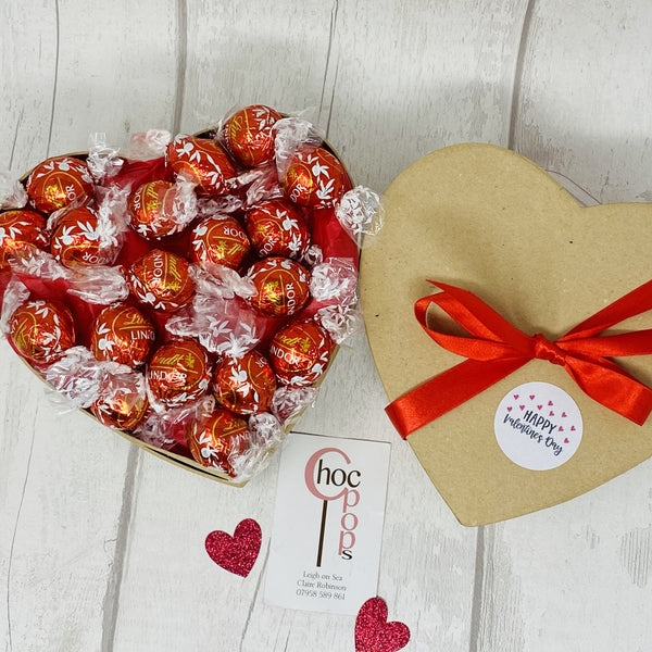 Heart shape gift box filled with sweets or chocolate