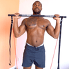 Man modeling the Redge Fit Portable Gym Machine with Redge Fit Extra Redge Bands Available at https://www.getredge.com/prodcuts/extra-redge-bands and https://www.getredge.com/products/bar