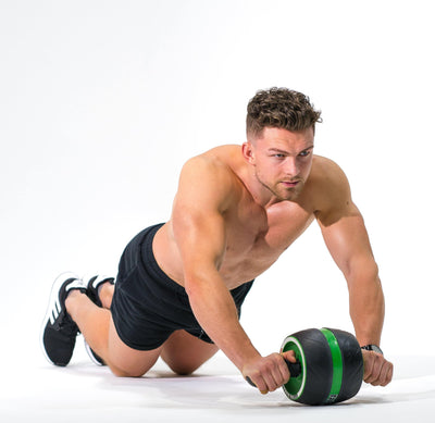 Man modeling the Redge Fit Full Body All In One Pack AB Roller Pro  Available at https://www.getredge.com/products/copy-of-core-focus-all-in-one-pack
