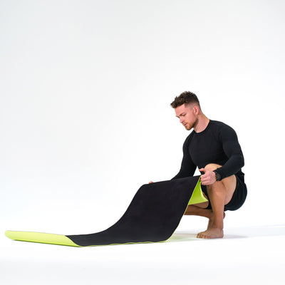 Man modeling the Redge Fit Double Sided Workout Mat Available at https://www.getredge.com/products/redge-double-sided-workout-mat