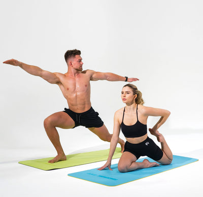 Man and Woman modeling the Redge Fit Double Sided Workout Mat Available at https://www.getredge.com/products/redge-double-sided-workout-mat