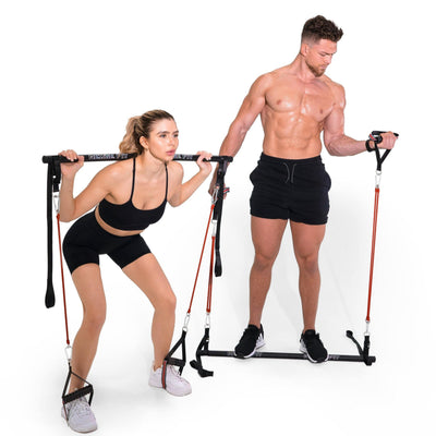 Man and Woman modeling the Redge Fit Home Gym Intermediate Pack Portable Gym Machine Available at https://www.getredge.com/products/home-gym-intermediate-pack