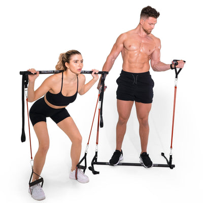Man and Woman modeling the Redge Fit Home Gym Starter Pack Portable Gym Machine Available at https://www.getredge.com/products/copy-of-home-gym-all-in-one-pack