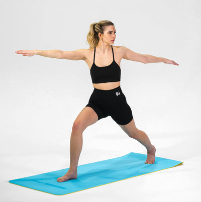 Woman modeling the Redge Fit Core Focus Yoga Mat Available at https://www.getredge.com/products/core-focus-all-in-one-pack