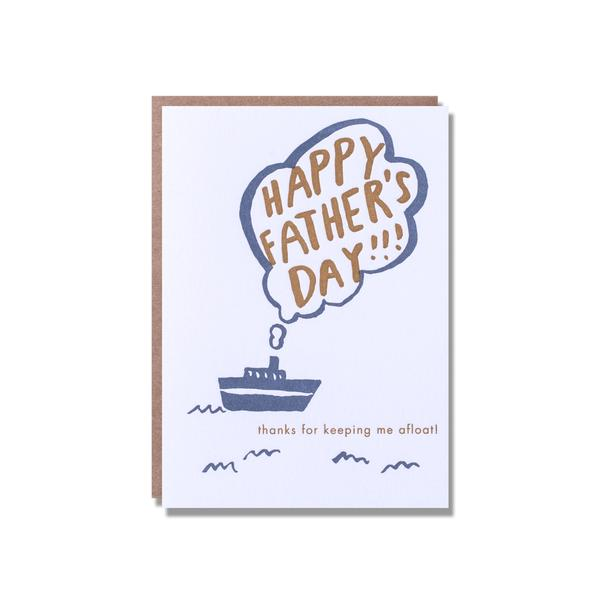 """Happy Father's Day"" written inside of the bubble coming from the ship chimney. a dark blue ship drawing on the middle.  ""Thanks for helping me afloat"" written on the bottom"
