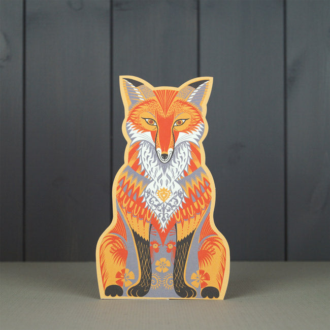 Art Angels by Sarah Young - Die-Cut Fox Felix    Felix Fox is a charming freestanding 3D die-cut card by artist Sarah Young  Published and printed by Art Angels, England.  The board of this card is produced by a paper mill in the UK and wood pulp comes from sustainable forests in Finland, both are FSC certified (Forestry Stewardship Certification). The cards are all printed by off-set litho and using vegetable-based inks.