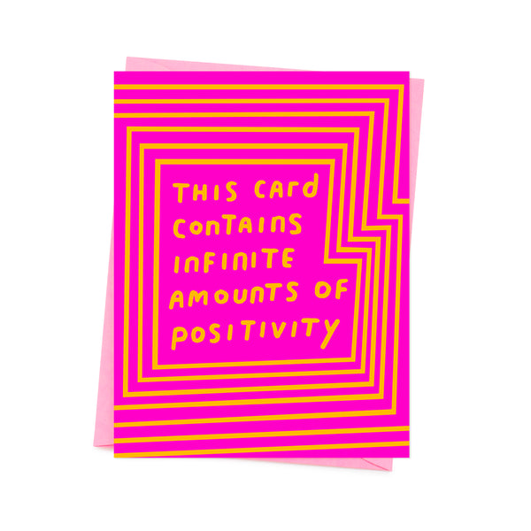yellow 'this card contains infinite amounts of positivity'  written on the pink base