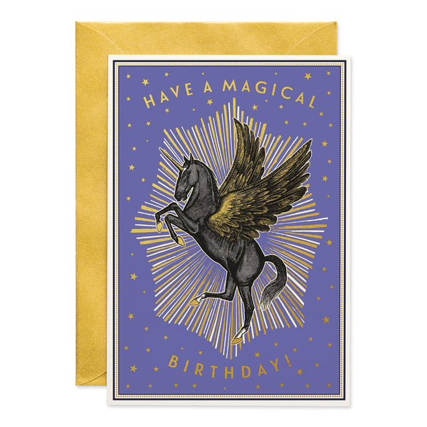 Black unicorn with open wings, golden 'have a magical birthday' written on the edges