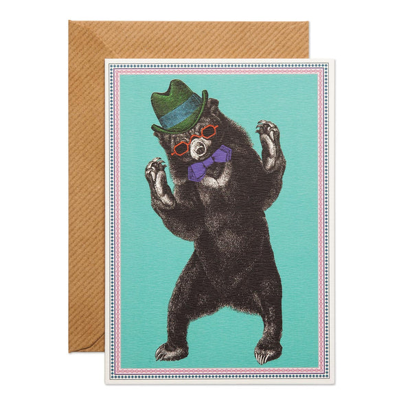 Party Bear Greeting Card -  a bear with a green hat, purple bow tie and red sunglasses. base baby blue