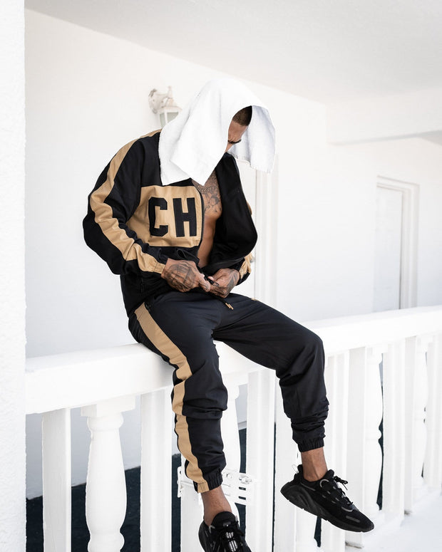 CAPO Panelled Shell Sweatpants Gold