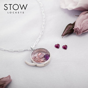 silver, gold, and rose gold Stow Lockets filled with petite charms
