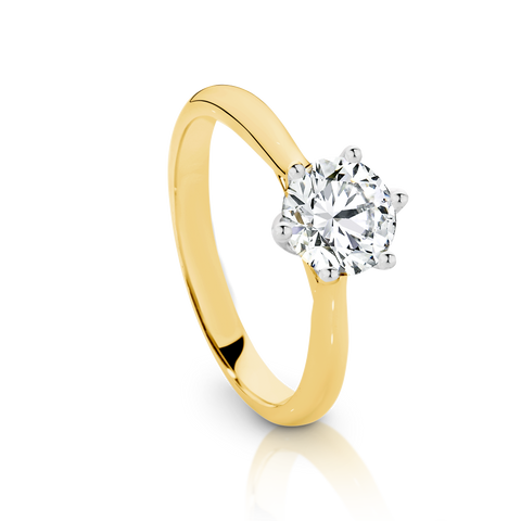 Our Signature Solitaire engagement ring set with a single 1.00ct Diamond.  18ct Yellow Gold.