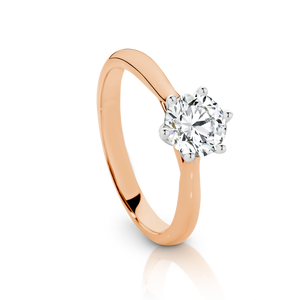 Our Signature Solitaire engagement ring set with a single 0.70ct Diamond.  18ct Rose  Gold.